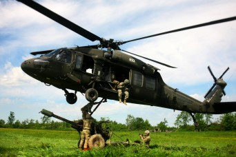 New York Army Guard aviators and artillerymen team up for joint training at Fort Drum