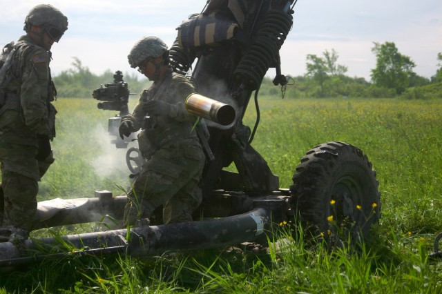 U.S. Soldiers assigned to Alpha Battery, 1st Battalion, 258th Artillery Regiment, 27th Infantry Brigade Combat Team, New York Army National Guard, man an M119A2 Howitzer during an air assault artillery raid at Fort Drum, N.Y. on June 9, 2017. During the raid soldiers in Alpha Battery were airlifted by two UH-60 Black Hawks to the landing zones where they then used their howitzers to engage a simulated enemy target.