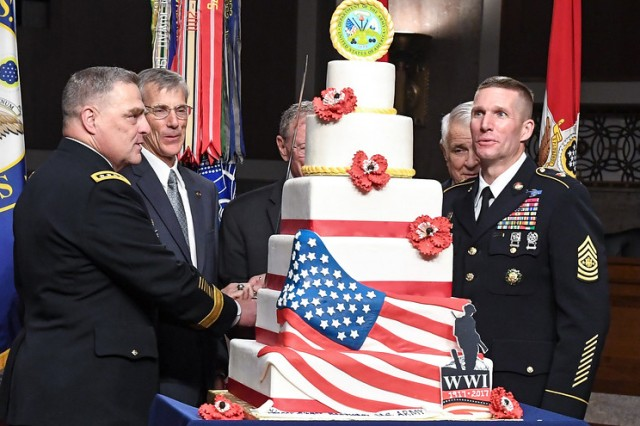 U.S. Army Chief of Staff Gen. Mark A. Milley cuts the cake for the Army's 242nd Army Birthday on Capitol Hill, June 14, 2017 along with Acting Secretary of the Army Robert M. Speer and Sergeant Major of the Army Daniel A. Dailey.