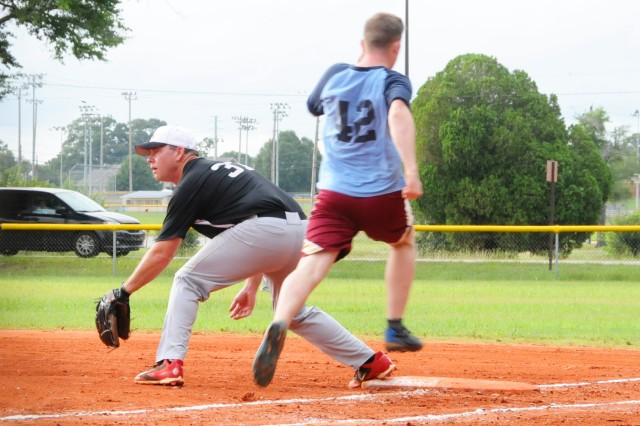 Second Lt. Zack Heibel, player for D Co., 1-145th, beats the ball to first during a game against the Fort Rucker Fire Department Plug Uglies at the Fort Rucker Softball Fields June 13.