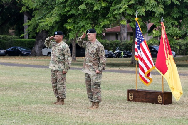 1st Sgt. Raymond B. Peredo of Yona, Guam (left) and 1st Sgt. Thomas A. Johnson of Mineral Point, Wis. (right) prepare to take part in the Headquarters and Headquarters Battery,  94th Army Air and Missile Defense Command change of responsibility ceremony June 14 at the Medal of Honor field on Joint Base Pearl Harbor-Hickam. During the ceremony Johnson assumed responsibility of HHB from Peredo.