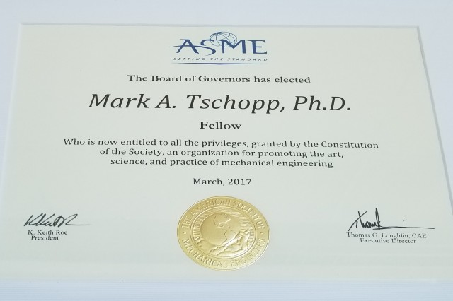 "The rank of American Society of Mechanical Engineers Fellow is presented to Army researcher Dr. Mark Tschopp for ""noteworthy invention, discovery or advancements,"" specifically citing significant achievements in research and development."