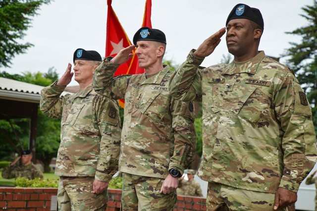 Lt. Gen. Gary Volesky (center), Brig Gen John Haley (left) and Col James Moore, salute the colors during the 593rd Expeditionary Sustainment Command Change of Command Ceremony at Watkins Field, Joint Base Lewis-McChord June 14, 2017.