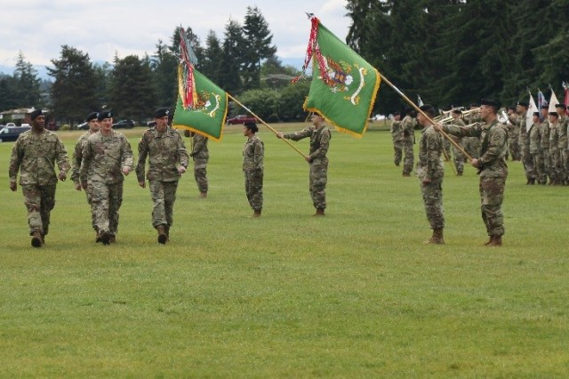 First Corps Commander Lt. Gen. Gary Volesky (center right) Brig. Gen. John Haley (center) and Col. James Moore, the incoming commander, inspect the troops during the 593rd Expeditionary Sustainment Command Change of Command ceremony at Watkins Field, Joint Base Lewis-McChord June 14, 2017.