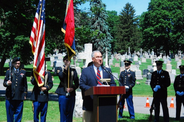 Retired New York Army National Guard Maj. Patrick Chaisson gives remarks during the rededication of a WWII headstone for Pfc. Silvio Campanella at the St. Agnes Cemetery in Albany, N.Y. June 14, 2017. Chaisson represented the Rainbow Division Veterans Foundation in the memorial ceremony and Soldiers of the 42nd Infantry Division Headquarters provided colors and honors.