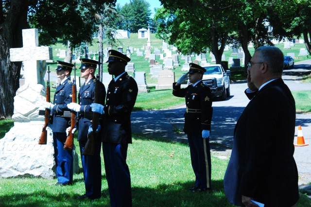 New York Army National Guard Soldiers of the 42nd Infantry Division Headquarters provide colors and honors at the rededication of a WWII headstone for Pfc. Silvio Campanella at the St. Agnes Cemetery in Albany, N.Y. June 14, 2017. Campanella's surviving family members received a new headstone depicting the corrected date of his death on January 19, 1945 courtesy of efforts of the Rainbow Division Veterans Foundation.