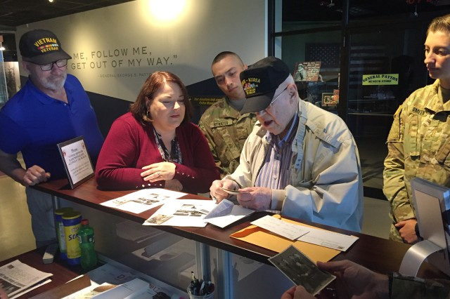 Ninety Seven-year-old WWII, Korea and Vietnam Veteran, Air Force Col. (Ret.) Vernon Greene presents some personal WWII-era photos and letters to Gen. George Patton Museum of Leadership Director Alice Hart. Greene donated the items to the museum for future exhibits.