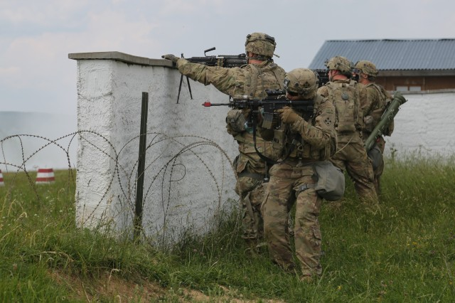 Soldiers of 1st Battalion, 66th Armor Regiment, 3rd Armored Brigade Combat Team, 4th Infantry Division, provide security while conducting an assault to liberate a town under siege by invading forces during Exercise Combined Resolve VIII at the Hohenfels Training Area, Hohenfels, Germany, June 12, 2017. Exercise Combined Resolve VIII is a full-spectrum exercise designed to train the U.S. Army Europe's Regionally Allocated Forces to work in a multinational environment that features more than 3,400 participants from 10 nations. The exercise prepares forces in Europe to operate together to promote stability and security in the region.