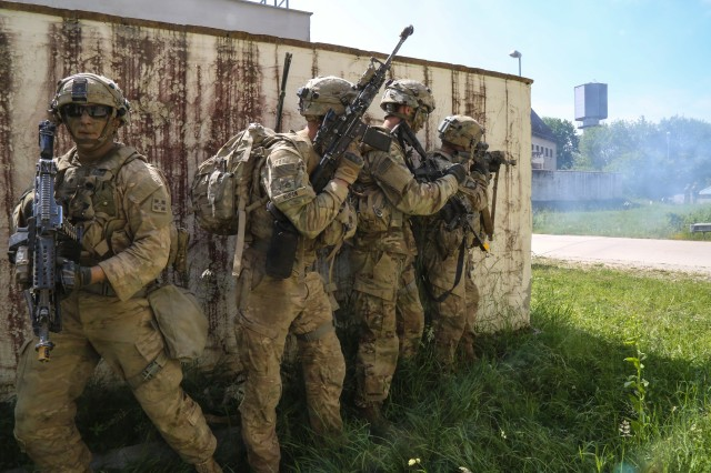 Soldiers of 588th Brigade Engineer Battalion, 3rd Armored Brigade Combat Team, 4th Infantry Division, prepare to clear buildings while conducting an assault to liberate a town under siege by an invader during Exercise Combined Resolve VIII at the Hohenfels Training Area, Hohenfels, Germany, June 12, 2017. Exercise Combined Resolve VIII is a full-spectrum exercise designed to train the U.S. Army Europe's Regionally Allocated Forces to work in a multinational environment that features more than 3,400 participants from 10 nations. The exercise prepares forces in Europe to operate together to promote stability and security in the region.