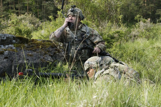 A Soldier of 1st Attack Reconnaissance Battalion, 501st Aviation Brigade, 1st Armored Division Combat Aviation Brigade, transmits information while conducting defensive operations as part of Task Force Iron, led by the 3rd Armored Brigade Combat Team, 4th Infantry Division, during Exercise Combined Resolve VIII at the Hohenfels Training Area, Hohenfels, Germany, June 8, 2017. Exercise Combined Resolve VIII is a full-spectrum exercise designed to train the U.S. Army Europe's Regionally Allocated Forces to work in a multinational environment that features more than 3,400 participants from 10 nations. The exercise prepares forces in Europe to operate together to promote stability and security in the region.