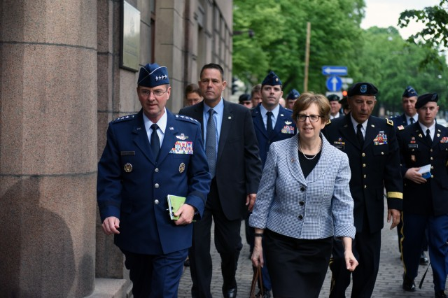 Air Force Gen. Joseph Lengyel, chief, National Guard Bureau, and Ambassador Nancy Pettit, ambassador to Latvia, walk to a meeting with Latvian leaders in Riga, Latvia, June 12, 2017.