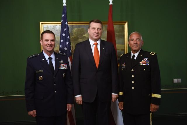 Air Force Gen. Joseph Lengyel, chief, National Guard Bureau; President Raimonds Vejonis, president of Latvia; and Army Maj. Gen. Greg Vadnais, adjutant general, Michigan National Guard, in Riga, Latvia, June 12, 2017.