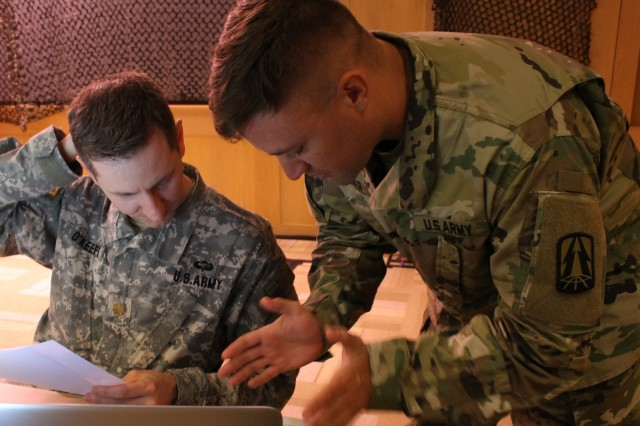 U.S. Army Maj. Tom O'Keefe (Left), assigned to the North Central Cyber Protection Center, a unit part of the Army Reserve Cyber Operations Group (ARCOG), 335th Signal Command (Theater), and Sgt. 1st Class Matthew R. Wagner (Right), a senior information systems analyst with the North East Cyber Protection Center, also part of the ARCOG, participate in a training exercise during the Cyber X-Games, hosted by the ARCOG, June 16 at Carnegie Mellon University. Cyber X-Games is a five-day exercise focusing on advanced areas of cyber security training.  Cyber X-Games is also part of Cyber Endeavour, the Department of Defense-sponsored conference for military and civilian practitioners from across government, industry and academia to address the nexus of cyberspace and national security.