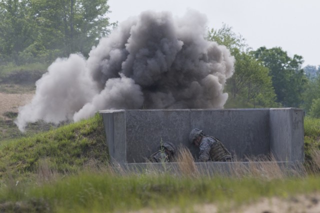 U.S. Army Spc. Jody Fabian, left, and Staff Sgt. David Hart, right, Alpha Company, 572nd Brigade Engineer Battalion, 86th Infantry Brigade Combat Team (Mountain), Vermont National Guard, take cover while a grenade detonates at Fort Drum, N.Y., June 13, 2017. Soldiers with the 572nd BEB qualified with hand grenades and other weapon systems during their annual training.
