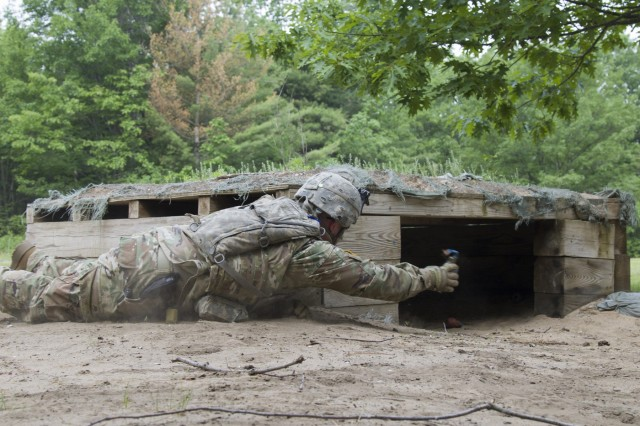 U.S. Army Spc. Nick Herschel, Alpha Company, 572nd Brigade Engineer Battalion, 86th Infantry Brigade Combat Team (Mountain), Vermont National Guard, throws a training grenade into a bunker at Fort Drum, N.Y., June 13, 2017. Soldiers with the 572nd BEB qualified with hand grenades and other weapon systems during their annual training.