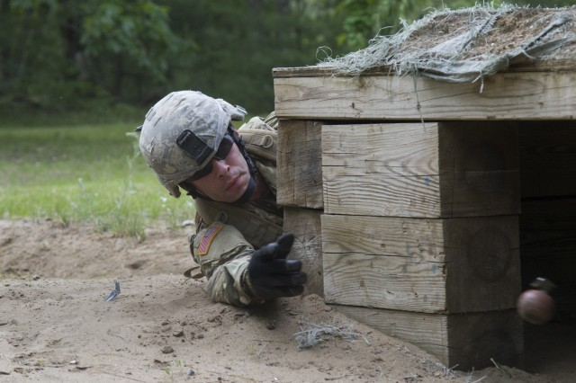 U.S. Army Sgt. Christopher Tomer, Alpha Company, 572nd Brigade Engineer Battalion, 86th Infantry Brigade Combat Team (Mountain), Vermont National Guard, throws a training grenade into a bunker at Fort Drum, N.Y., June 13, 2017. Soldiers with the 572nd BEB qualified with hand grenades and other weapon systems during their annual training.
