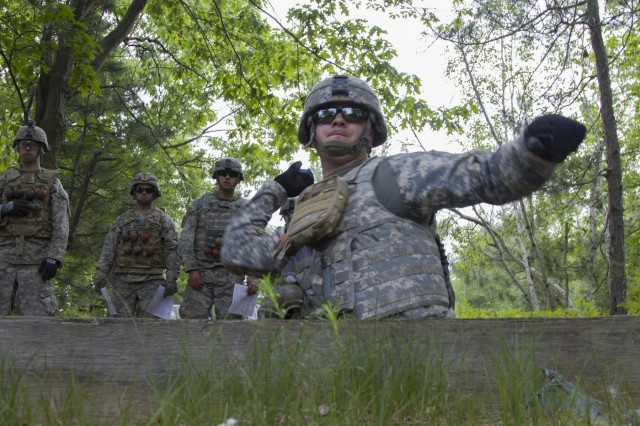 U.S. Army Sgt. Isaac Pomer, Alpha Company, 572nd Brigade Engineer Battalion, 86th Infantry Brigade Combat Team (Mountain), Vermont National Guard, throws a training grenade at Fort Drum, N.Y., June 13, 2017. Soldiers with the 572nd BEB qualified with hand grenades and other weapon systems during their annual training.