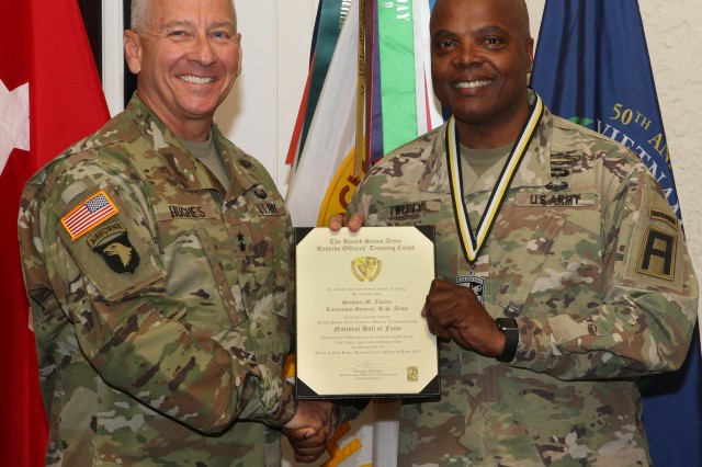 Maj. Gen. Christopher Hughes, commander of U.S. Army Cadet Command and Fort Knox, presents a certificate to Lt. Gen. Stephen Twitty, commander of First United States Army, signifying his induction into the ROTC National Hall of Fame June 14 at Fort Knox.