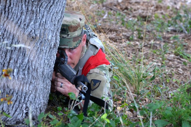 Staff Sgt. Joseph Conrad takes cover to return simulated fire during a situational training exercise as part of the 2017 Army Contracting Command Best Warrior Competition June 7 at Joint Base San Antonio-Camp Bullis, Texas. Conrad was one of seven Soldiers from throughout the command vying for the best warrior title over five days of competition and the right to represent ACC at the Army Materiel Command level in July. Conrad is a contracting non-commissioned officer with the 614th Contracting Team at Fort Bragg, North Carolina.