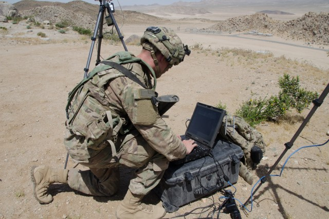 Soldiers of the 780th Military Intelligence Brigade set up cyber tools at the National Training Center at Fort Irwin, Calif., May 7, 2017. The 780th participated in the NTC training rotation for the 2nd Armored Brigade Combat Team, 1st Infantry Division, as part of the Army Cyber Command-led Cyber-Electromagnetic Activities (CEMA) Support to Corps and Below initiative. The Army is delivering a range of prototypes for defensive cyberspace operations, focused on both the infrastructure and the tools needed to defend against attacks on Army systems and networks. (Photo credit: Bill Roche, ARCYBER)