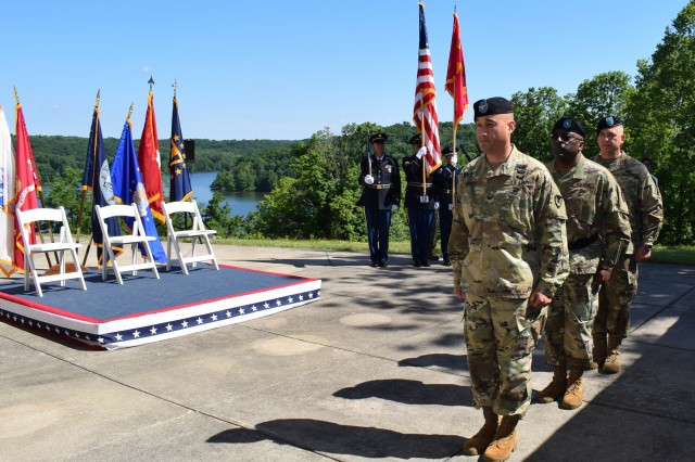 (Left to right) Col. James Hooper, outgoing commander of Crane Army Ammunition Activity, Brig. Gen. Richard Dix, commanding general of Joint Munitions Command, and Col. Michael Garlington, incoming commander of CAAA, march into Crane Army's change of command ceremony on June 19.