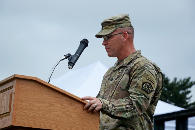 FORT MEADE, Md. - Lt. Col. Jimmy T. Gaw relinquishes command of the 742nd Military Intelligence battalion during a change of command ceremony June 16 on Fort Meade.