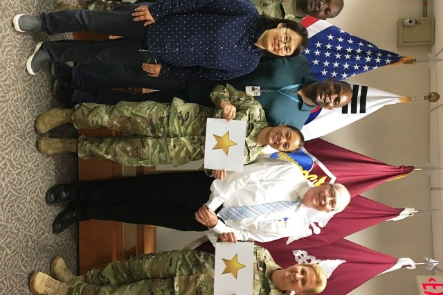 (Left to Right) 1st Sgt. Marcus Miller, the acting senior enlisted advisor, Brian Allgood Army Community Hospital (BAACH), Un Chong Cho, safety specialist, BAACH, Larry Maxey, safety and occupational health specialist, 1s Lt. Suzume Spillers, safety manager, George LeFevre, MEDCOM safety manager and Col. Erica Clarkson, BAACH commander celebrate the successful completion of the Army's Safety and Health Management System audit on June 16, 2017.  BAACH will host a celebration ceremony of being recognized as one of the safest places to work on the arrival of the safety star banner in August 2017.