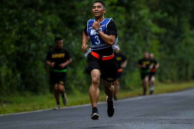 Sgt. First Class Glenn C. Agngarayngay, assigned to 1st Battalion, 196th Infantry Brigade, United States Army Pacific Command, runs towards the finish line during the final event of the Army Physical Fitness Test as part of the Pacific Theater Best Warrior Competition on June 12, 2017 at Schofield Barracks, Hawaii. The APFT was the first event for the competitors prior to conducting the combat run, obstacle course and range qualification.