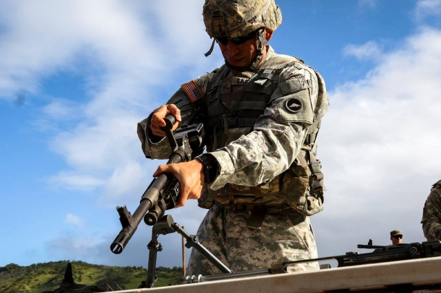 Sgt. Gerardo Saavedra, 88th Military Police Detachment, U.S. Army in Japan, assembles a 240B Light Machine Gun on Day 2 of the Pacific Theater Best Warrior Competition, June 13, 2017 at Schofield Barracks, Hawaii. The contest will determine who is the best Soldier and Noncommissioned Officer in the Pacific.