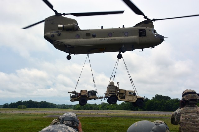 A CH-47 Chinook flown by Soldiers from the 101st Combat Aviation Brigade, 101st Airborne Division (Air Assault), sling loads the Tactical Control Node-Light at Fort Campbell, Ky., Jun. 15, 2017. The training was part of 2nd Brigade, 101st's preparation for the upcoming Network Integration Exercise at Fort Bliss, where they will be the first light BCT to participate.