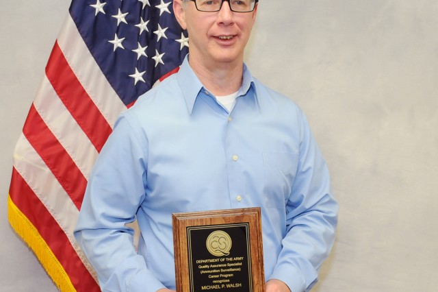 Mike Walsh, Joint Munitions Command Quality Assurance Ammunition Surveillance expert, displays his 2017 QASAS of the Year award.