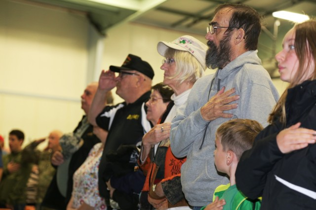 Vietnam veterans and their families participate in the Vietnam Veterans Welcome Home Ceremony on May 20, 2017, at Fort McCoy, Wis. Each veteran received a Vietnam Veterans Lapel Pin during the event. The ceremony was one of many taking place around the United States that officially recognizes veterans who served between May 1, 1955, and Nov. 15, 1975. The ceremony also was held in conjunction with the 2017 Fort McCoy Armed Forces Day Open House. (U.S. Army Photo by Scott T. Sturkol, Public Affairs Office, Fort McCoy, Wis.)