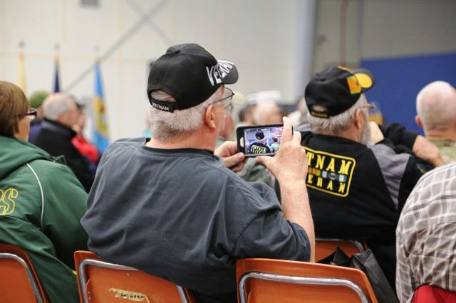 Vietnam veterans and their families participate in the Vietnam Veterans Welcome Home Ceremony on May 20, 2017, at Fort McCoy, Wis. Each veteran attending the ceremony received a Vietnam Veterans Lapel Pin during the event. The ceremony was one of many taking place around the United States that officially recognizes veterans who served between May 1, 1955, and Nov. 15, 1975. The ceremony also was held in conjunction with the 2017 Fort McCoy Armed Forces Day Open House. (U.S. Army Photo by Scott T. Sturkol, Public Affairs Office, Fort McCoy, Wis.)