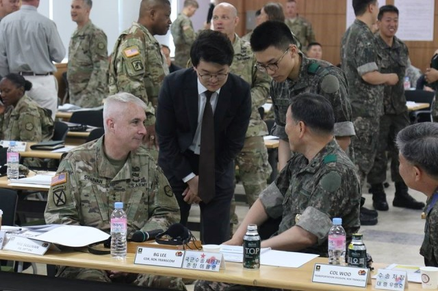 Maj. Gen. John P. Sullivan, Commanding General of the 19th Expeditionary Sustainment Command, engages in discussions with Brig. Gen. Yul Hoon Lee, Commanding General of the Republic of Korea Transportation Command. Senior logistics leaders gathered with the ROK TRANSCOM and KORAIL representatives for the 5th Combined Movement Control Tactical Discussion at the KORAIL headquarters, June 20, 2017.