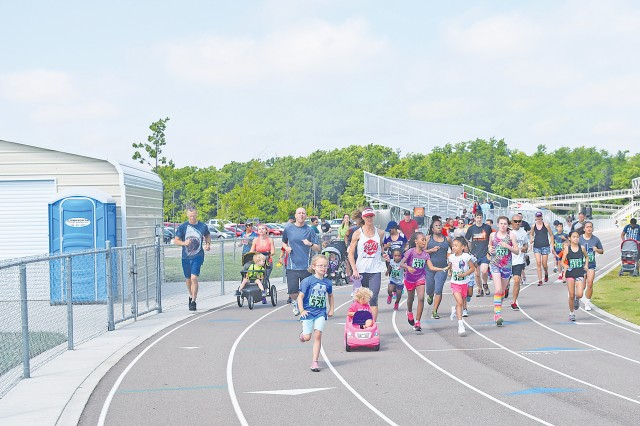 "Staff of the Directorate of Family and Morale, Welfare and Recreation hosted the ""Big Red One"" Youth Track Meet and Peter Rabbit Fun Run June 10. Events included the 100-meter, 200-meter and 400-meter dashes as well as a 2-mile fun run at Fort Riley Middle School."