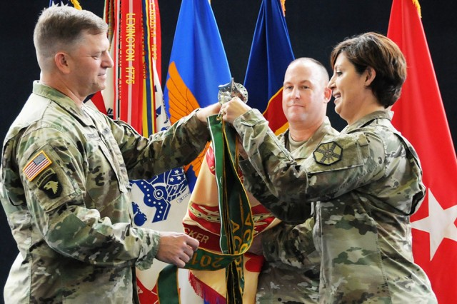 Maj. Gen. William K. Gayler, U.S. Army Aviation Center of Excellence and Fort Rucker commanding general, along with Col. Shannon T. Miller, Fort Rucker garrison commander, affix the 2017 ACOE Silver Award streamer to the garrison colors during a ceremony at the U.S. Army Aviation Museum June 19.