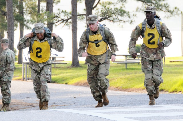 AIT Warrior Challenge winners Pvt. Camillo Loyuk, Pfc. Tyler Meche and Pvt. Isiah Williams set off on the road march portion of the competition.
