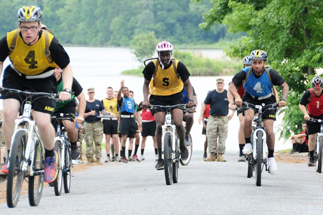 Soldier competitors of A Co., 1-13th Avn. Regt., set out on a 6-1/2-mile bike ride during the AIT Warrior Challenge.