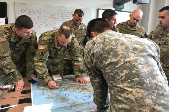 U.S. Army officers and non-commissioned officers assigned to the 1st Battalion, 69th Infantry of the New York Army National Guard work their plan for the Talisman Sabre joint training exercise with the Australian Army's 1st Brigade during a visit to Australian on May 20, 2017. Eight hundred New York Army National Guard Soldiers, with a task force built around the 1st Battalion 69th Infantry, will participate in the Talisman Sabre Australian/U.S. exercise in July, 2017.