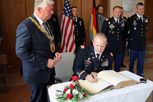 U.S. Army Col. Rob Parker, commander of 5th Signal Command (Theater) and the U.S. Army Europe chief information officer/G-6, signs the Golden Book of Worms at a farewell ceremony for the command June 21, 2017 in Worms, Germany. 5th Signal Cmd. was headquartered at Taukkunen Baracks in Worms from 1974 to 1996, and will inactivate later this year. The Golden Book of Worms dates back to 1883 and has entries and signatures from a number of dignitaries to visit the city, including Czar Nicholas II of Russia.