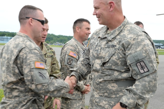 U.S. Army National Guard Soldier, Chief Warrant Officer 5, assigned to 1st Battalion, 142nd Aviation, greets well wishers at the Army Aviation Support Facility #3, Latham, N.Y., June 22, 2017. Rodda completed his Final Flight with the New York Army National Guard, an important ceremony for Air Force and Army pilots, marking their last flight with the military. (U.S. Army National Guard photo by Pfc. Andrew Valenza)