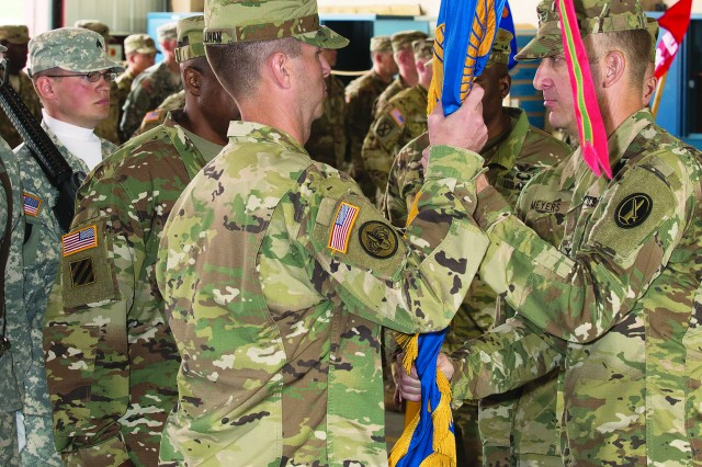 Lt. Col. Brendan J. Cullinan, receives the guidon from Col. Prescott R. Farris, commander, U.S. Army Aviation Brigade, during a change of command/change of responsibility ceremony June 23, 2017, at Fort Belvoir, Va.