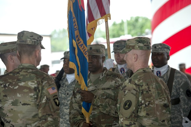 Command Sgt. Maj. Bernard Brooks Jr., incoming command sergeant major, prepares to pass the guidon to Lt. Col. Edward Meyers, the outgoing commander, during the change of command/change of responsibility ceremony June 23, 2017, at Fort Belvoir, Va.