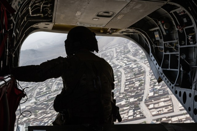 A U.S. Army Reserve CH-47 Chinook helicopter pilot deployed with Task Force Warhawk, 16th Combat Aviation Brigade, 7th Infantry Division scans below over Kandahar, Afghanistan, June 21, 2017. The Warhawks provide aviation support to U.S. Forces Afghanistan as part of Operation Freedom's Sentinel.