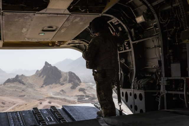 A U.S. Army Reserve CH-47 Chinook helicopter pilot deployed with Task Force Warhawk, 16th Combat Aviation Brigade, 7th Infantry Division scans below during landing near Kandahar, Afghanistan, June 21, 2017. The Warhawks provide aviation support to U.S. Forces Afghanistan as part of Operation Freedom's Sentinel.