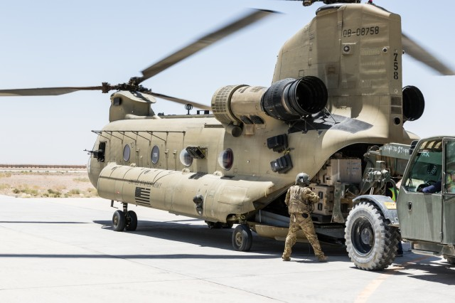 A U.S. Army Reserve CH-47 Chinook helicopter crew chief deployed with Task Force Warhawk, 16th Combat Aviation Brigade, 7th Infantry Division supervises loading in Helmand Province, Afghanistan, June 21, 2017. The Warhawks provide aviation support to U.S. Forces Afghanistan as part of Operation Freedom's Sentinel.
