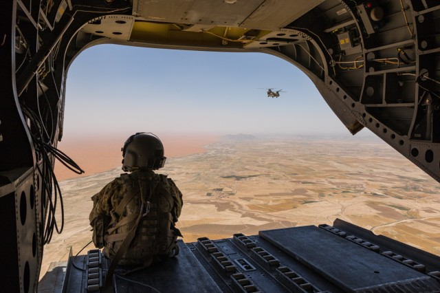 A U.S. Army Reserve CH-47 Chinook helicopter pilot deployed with Task Force Warhawk, 16th Combat Aviation Brigade, 7th Infantry Division scans below over the Registan Desert in Helmand Province, Afghanistan, June 21, 2017. The Warhawks provide aviation support to U.S. Forces Afghanistan as part of Operation Freedom's Sentinel.