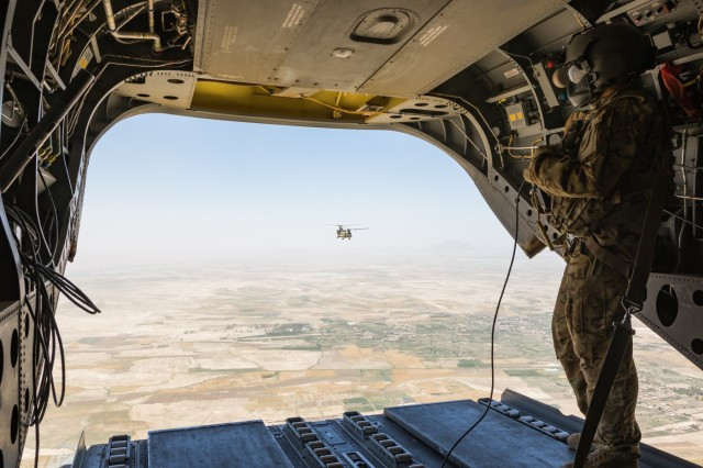 A U.S. Army Reserve CH-47 Chinook helicopter pilot deployed with Task Force Warhawk, 16th Combat Aviation Brigade, 7th Infantry Division scans below over Helmand Province, Afghanistan, June 21, 2017. The Warhawks provide aviation support to U.S. Forces Afghanistan as part of Operation Freedom's Sentinel.