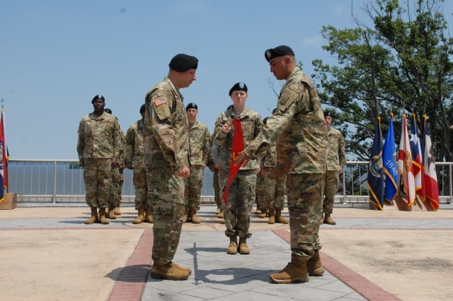 Capt. Samuel Horwitz, commander of Battery A, 3rd Air Defense Artillery Regiment, 108th Air Defense Artillery Brigade, and Sgt. 1st Class Gabriel Ibarra, Battery First Sergeant, case the unit's colors at Aberdeen Proving Ground, Maryland, during the unit's inactivation ceremony on June 15, 2017.  A-3 was conducting a homeland defense mission in the National Capital Region.