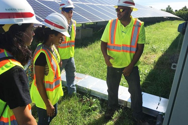 William J. Eggleston III, right, a safety engineer with the U.S. Army Engineering and Support Center, Huntsville's Safety Office, explains a solar array project at Fort Campbell, Kentucky, to summer hire, Lorraine Rosello Del Valle; Erika Cosper, a Pathways Intern; and Jacob Morrison, a summer hire during a recent trip to Fort Campbell. Work on the solar array began in 2012 when the Fort Campbell Directorate of Public Works partnered with the Huntsville Center and the Department of Energy to put together a renewable energy plan for the post